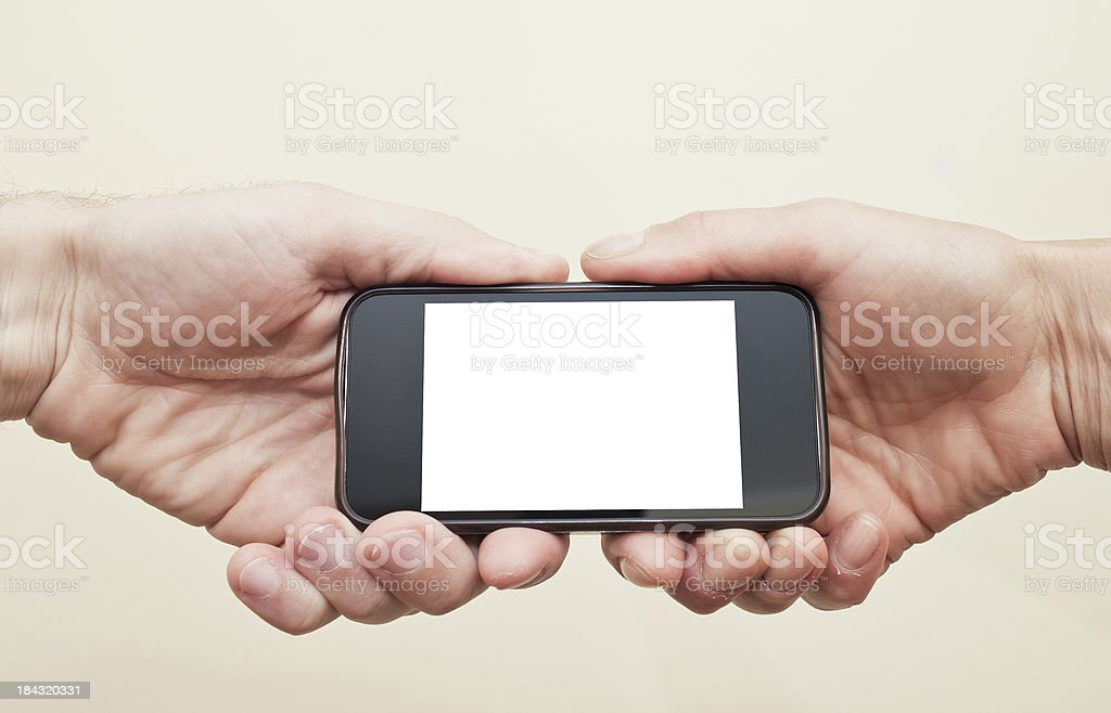 Two Hands Holding The Same Smart Phone royalty-free stock photo