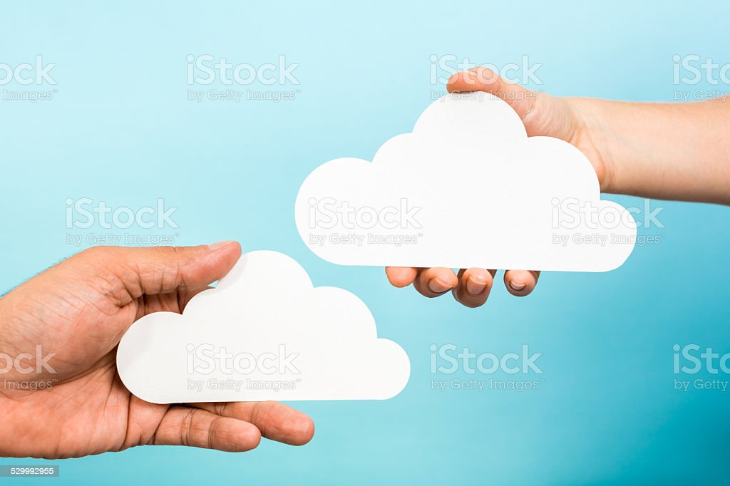 Two hands holding white empty clouds. Cloud computing storage concept royalty-free stock photo