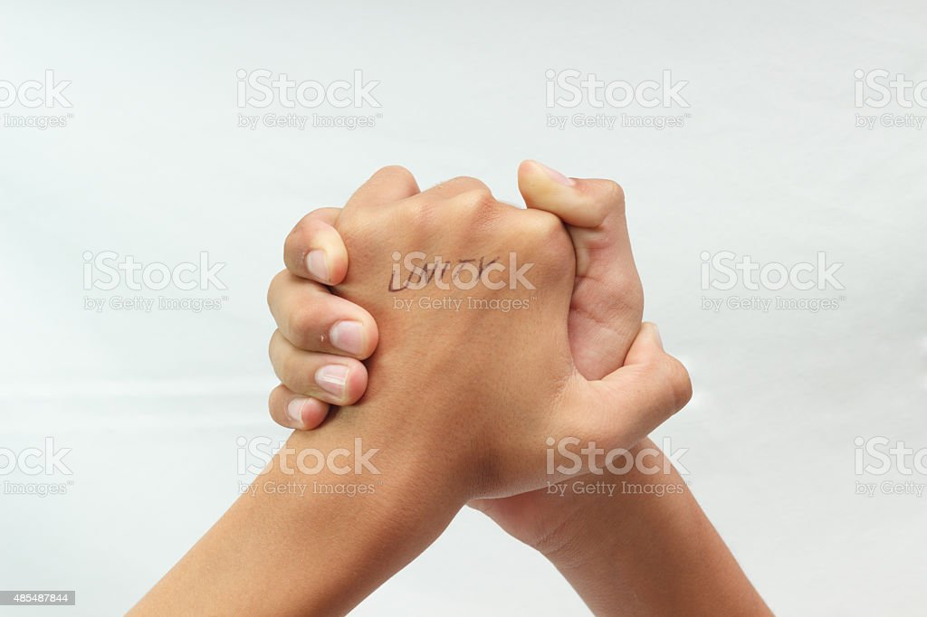 Two Hands In A Handshake On White Background Unity Stock Photo - Download  Image Now