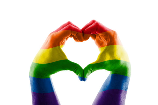 Two hands in the form of LGBT rainbow heart symbol of love stock photo