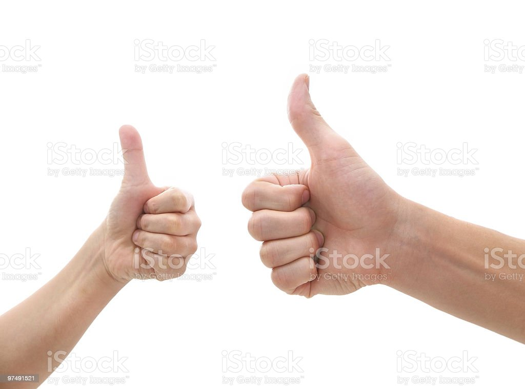 two hands making thumbs up gesture royalty-free stock photo