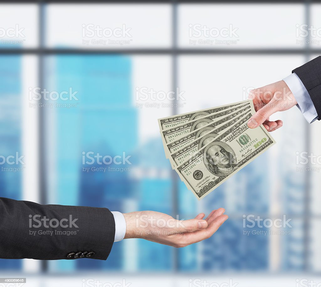 Two hands, money transferring process. stock photo