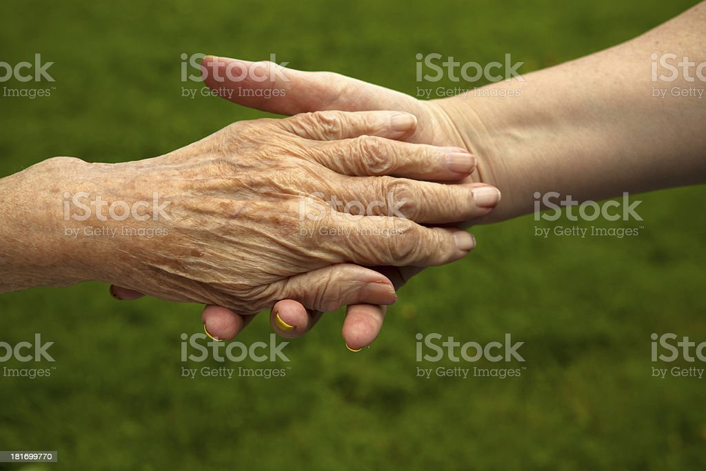 Two hands, mother and daughter. stock photo