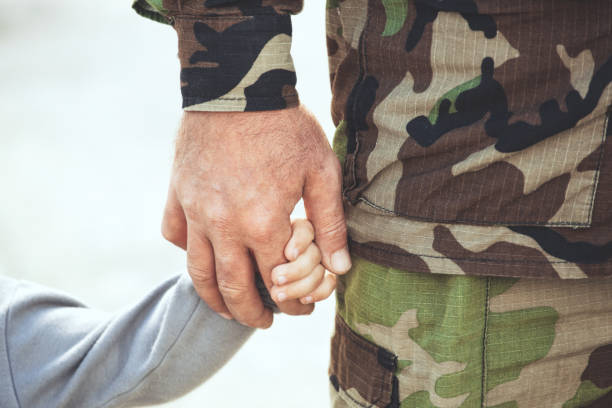 two hands  of one family - father and child together. - armed forces stock photos and pictures