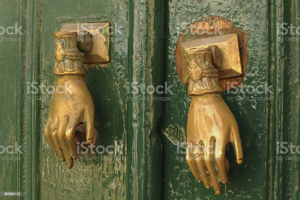 Two hands on the door royalty-free stock photo