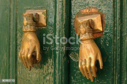 istock Two hands on the door 90393110