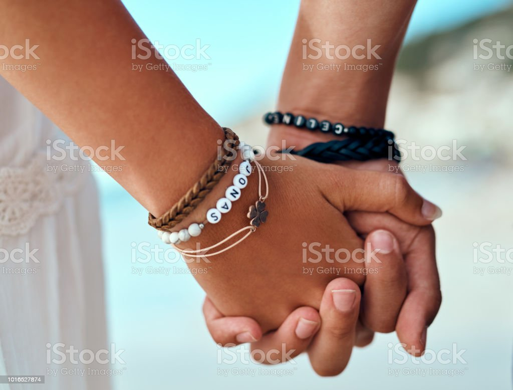 Two hands, one heart stock photo