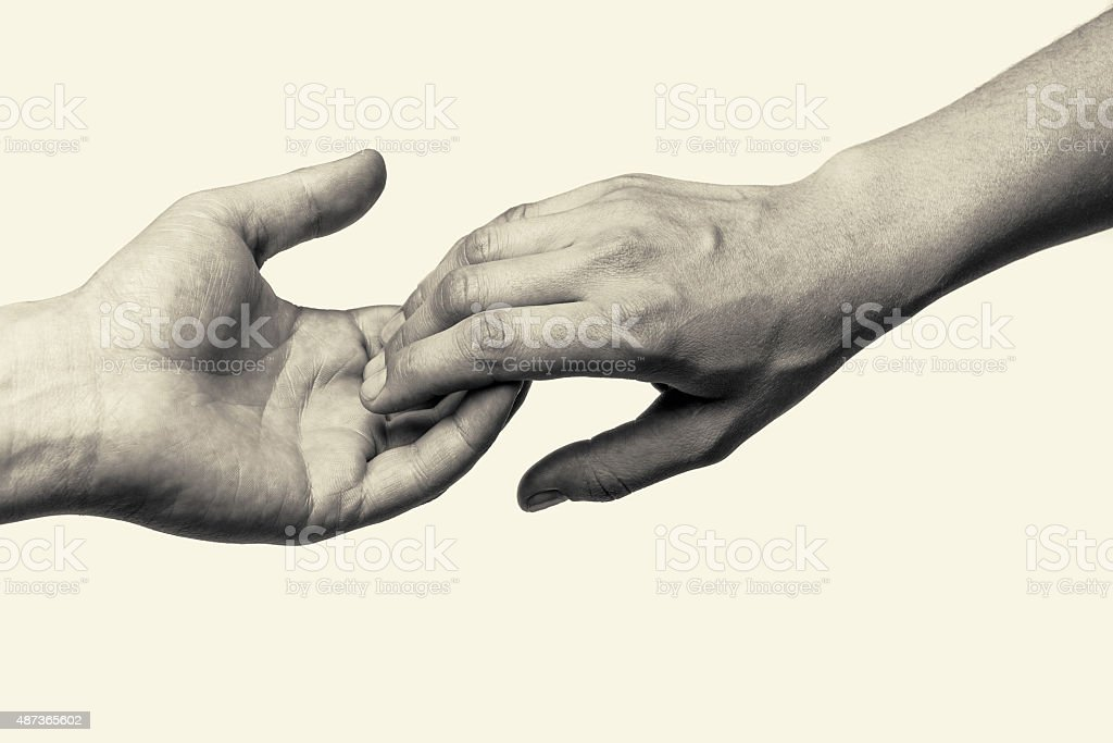 Two hands - parting stock photo