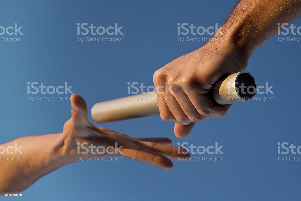 Two Hands Passing Relay Baton Race stock photo
