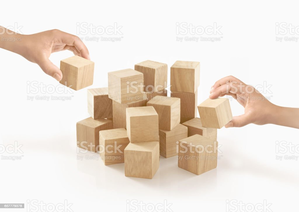 Two hands playing wooden box on isolated background. stock photo