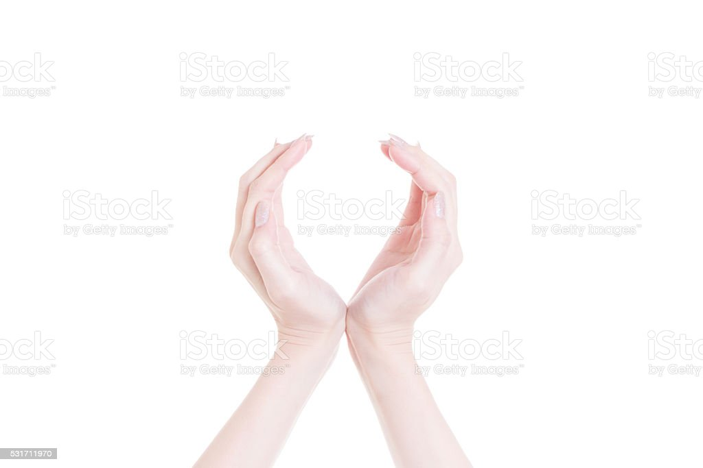 Two hands protecting something on white background stock photo