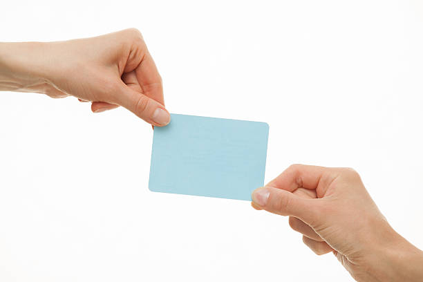 Two hands pull in different directions a blue paper card Two hands pull in different directions a blue paper card, white background pulling stock pictures, royalty-free photos & images