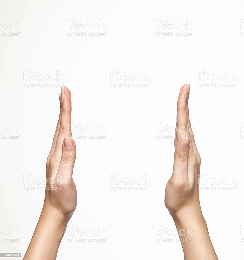 Two hands raised and spread apart as if about to clap royalty-free stock photo