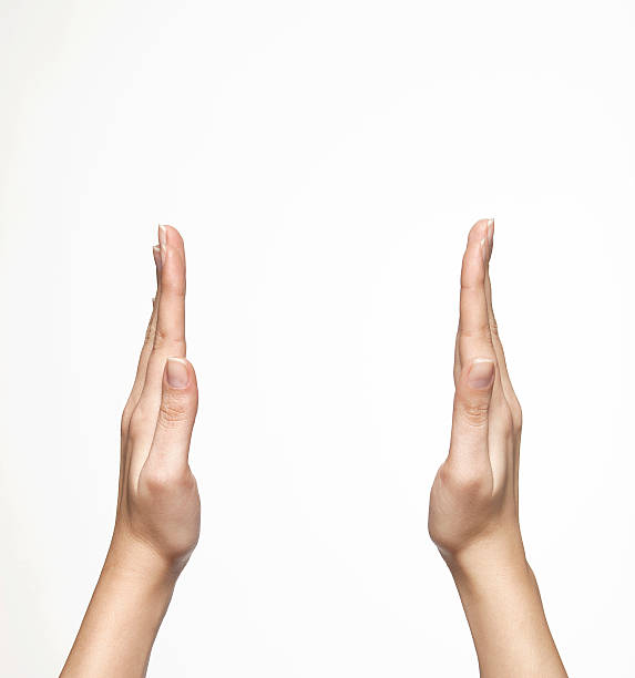 Two hands raised and spread apart as if about to clap stock photo