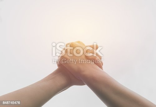 istock Two hands reaching toward each other. Teamwork and helping concept. 848745476