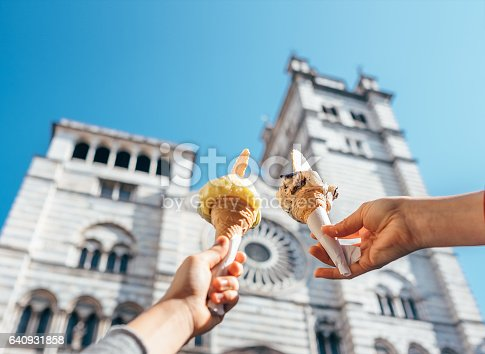 istock Two hands takes ice cream nearthe San Lorenco Cathedral 640931858