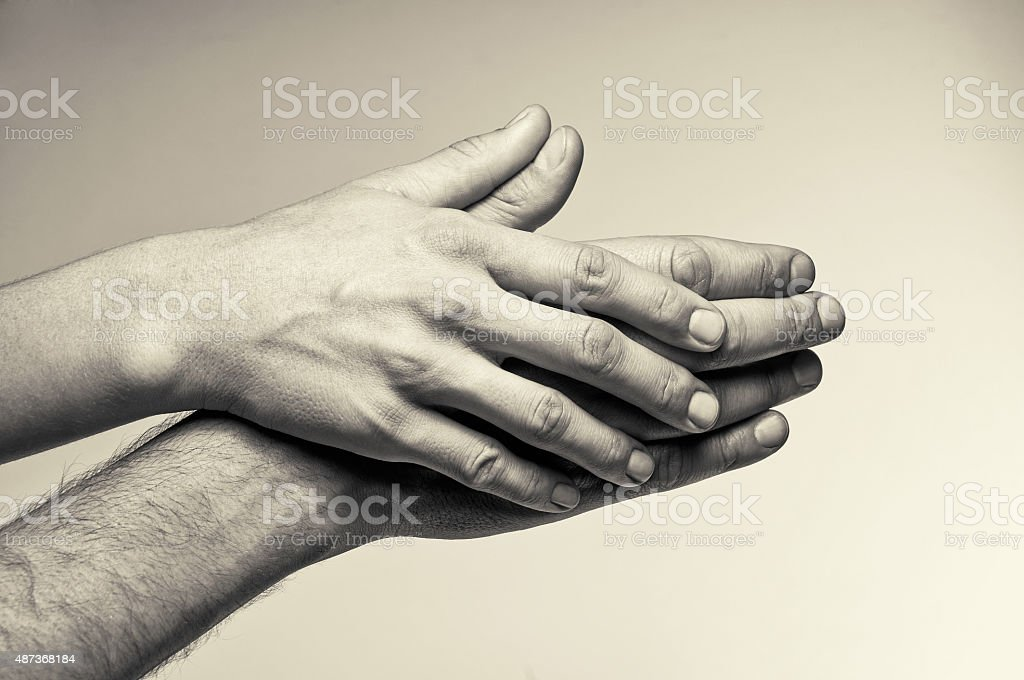 Two hands - tenderness stock photo