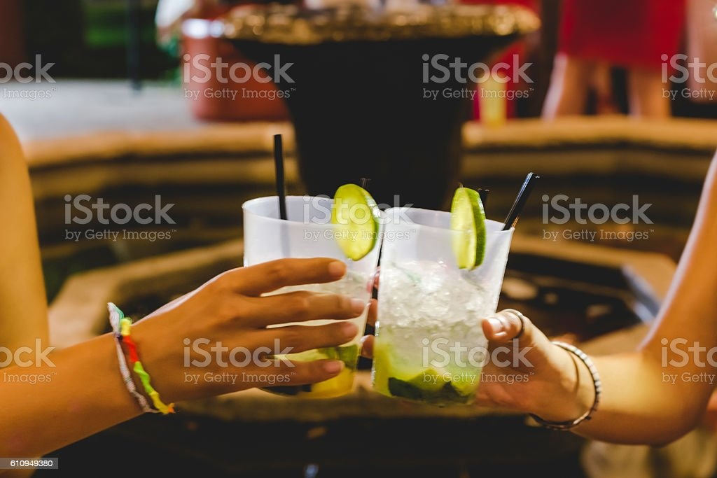 Two hands toast coctail in restaurant outdoor stock photo