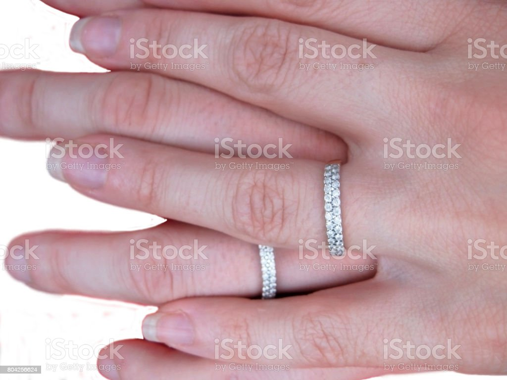 Two hands two rings and two hearts