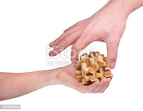 istock two hands with a puzzle 534666363