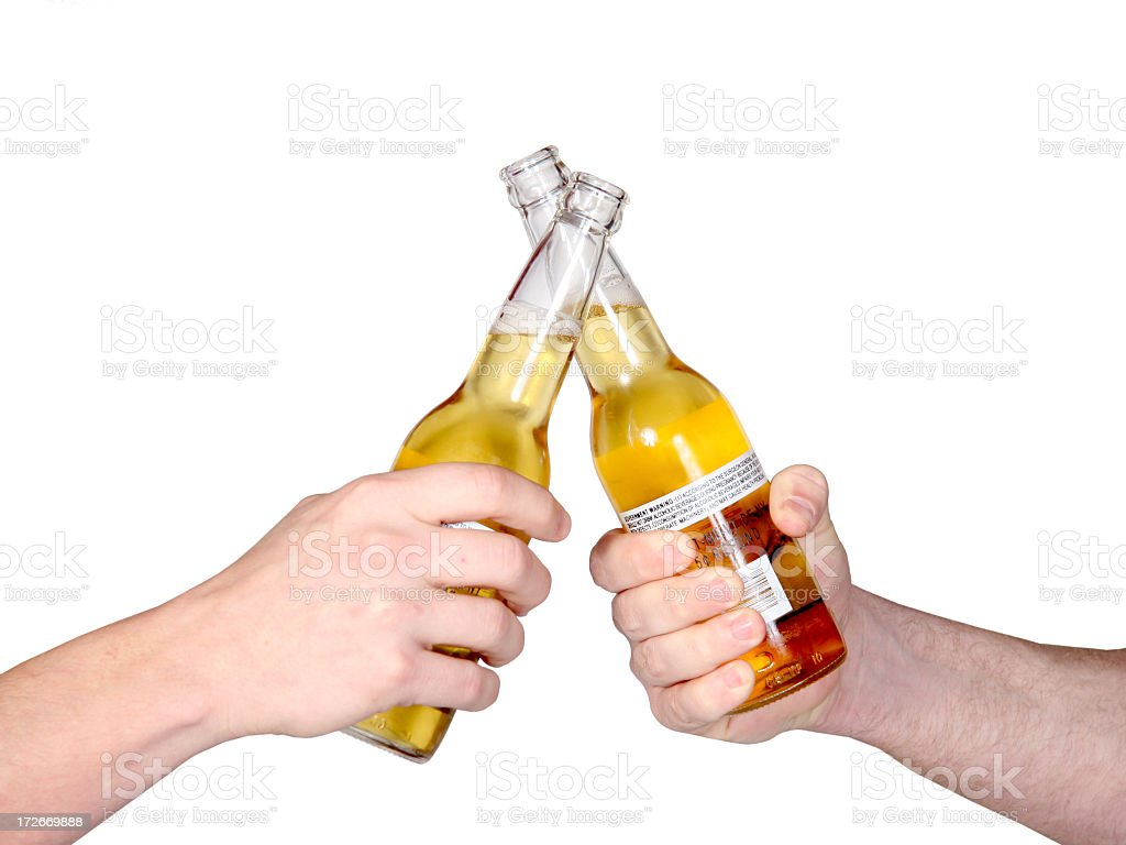 Two hands with beers cheering each other royalty-free stock photo