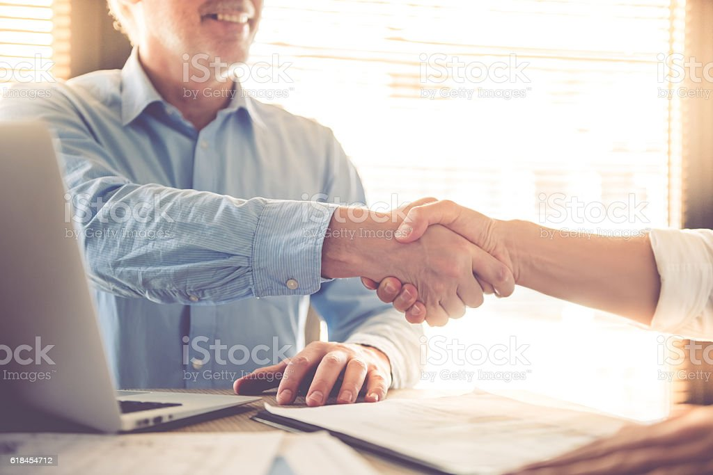 Two handsome businessmen working stock photo