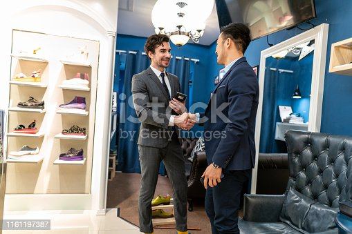 istock Two handsome man shaking hands after dealing a job 1161197387