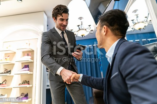 istock Two handsome man shaking hands after dealing a job 1161197411