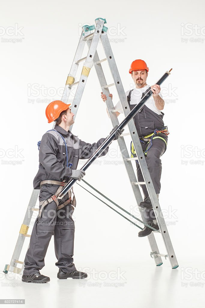Two handymen at work stair stock photo
