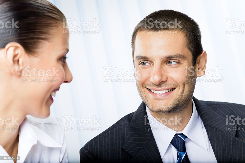 Two happy businesspeople, or businessman and client, at office royalty-free stock photo