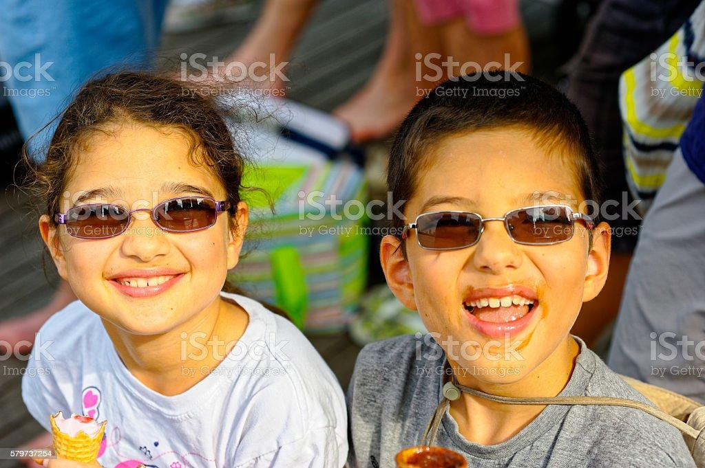 Two Happy Children Eating Ice-Cream stock photo
