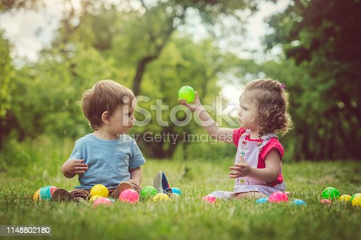 915609494istockphoto Two happy children playing in springtime in park 1148802180