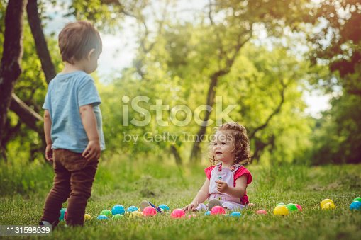 915609494istockphoto Two happy children playing in summer park 1131598539