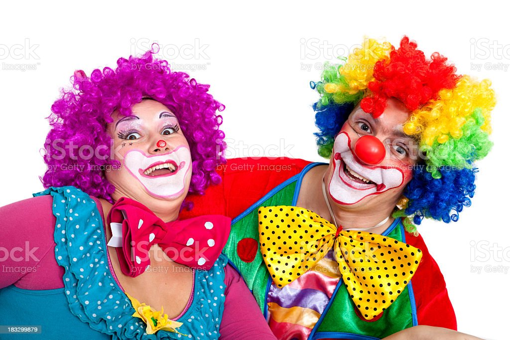 Two Happy Clowns Making Faces On White