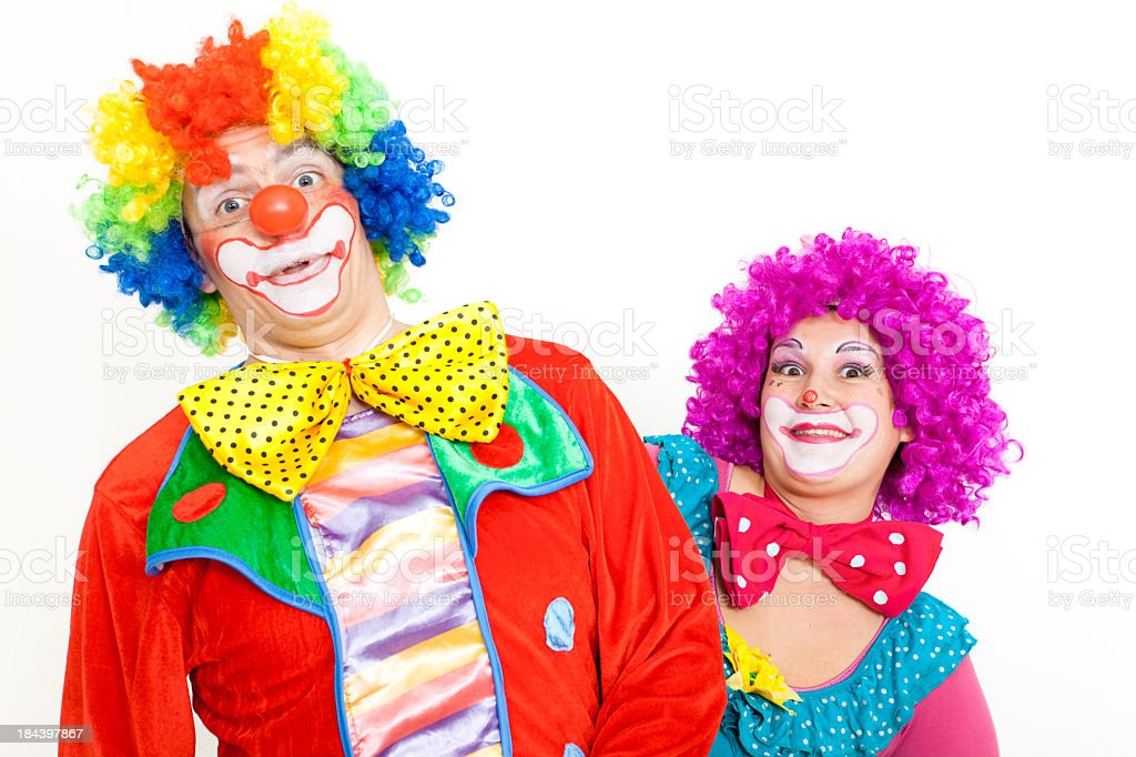 Two Happy Clowns Making Faces Stock
