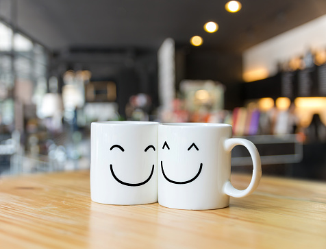 istock Two happy cups on coffee store blur background, Valentine lover concept 843265624