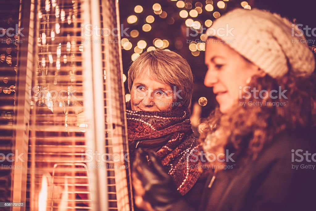 Two Happy Female Friends and Fire, Night, Christmas, Carinthia, Austria stock photo