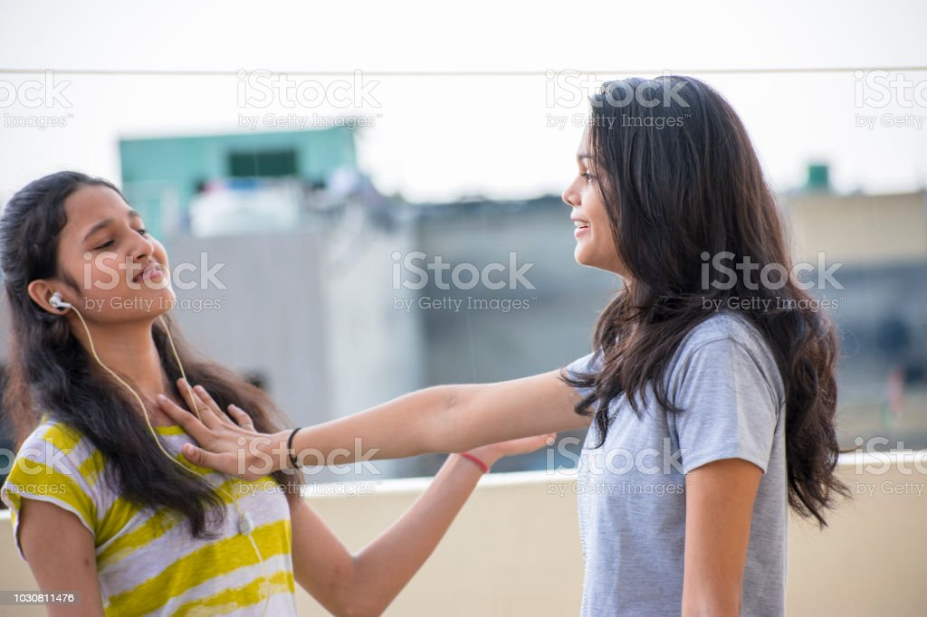 Two Happy Friends Girl Pushing Her Friend Stock Photo Download Image Now Istock