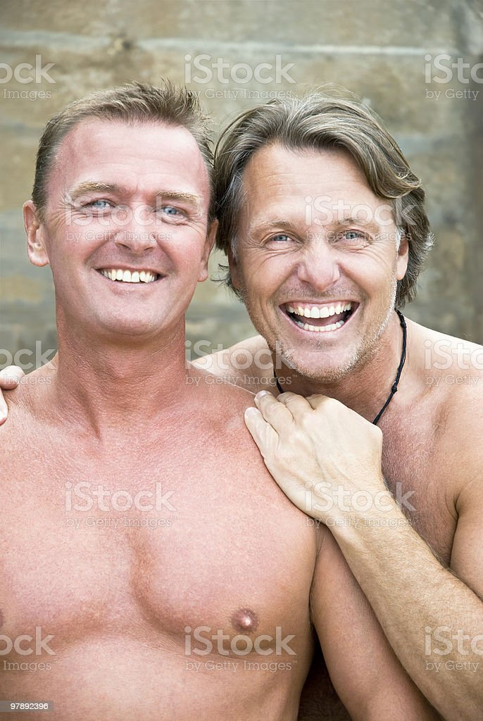 Two happy gay men cuddling. royalty-free stock photo