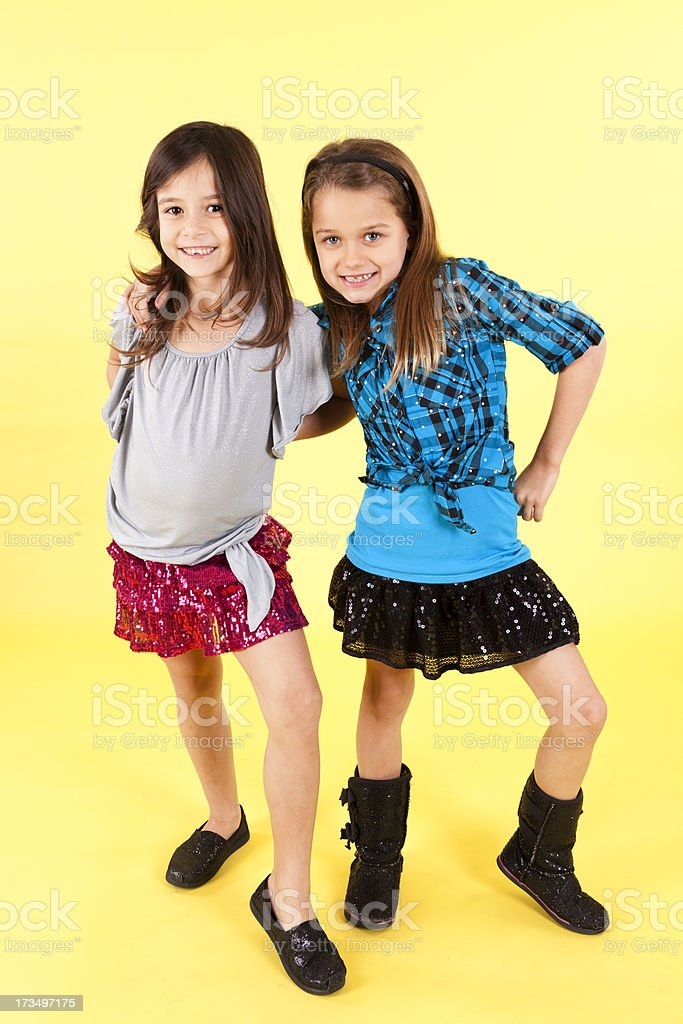 Two happy girls 7-8, smiling and embracing each other royalty-free stock photo