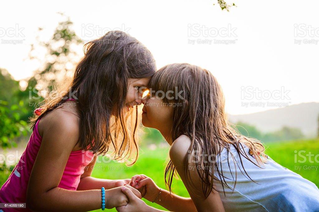Two happy girls outside – Foto