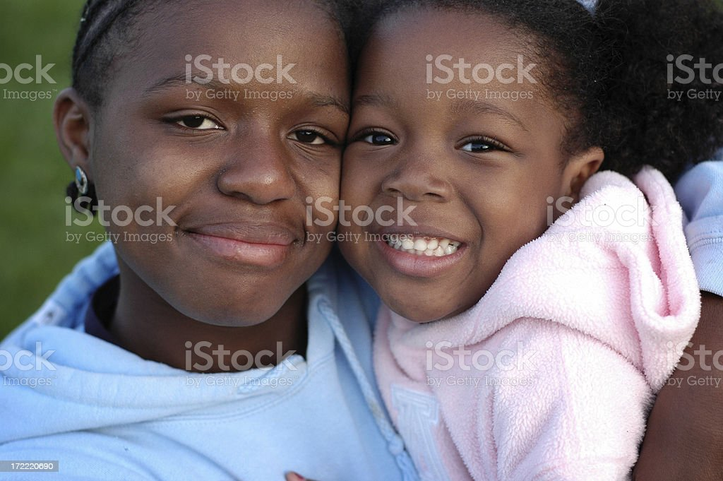 Two Happy Girls Smiling and Hugging Each Other royalty-free stock photo