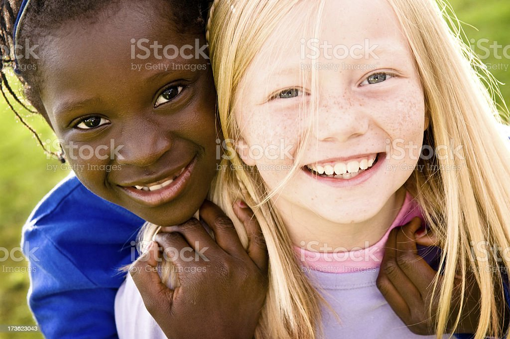 Two Happy Girls Smiling and Playing Together Outside royalty-free stock photo