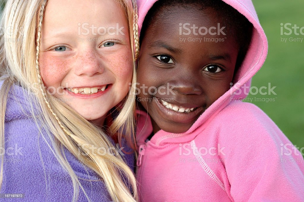 Two Happy Girls Smiling Together Outside stock photo