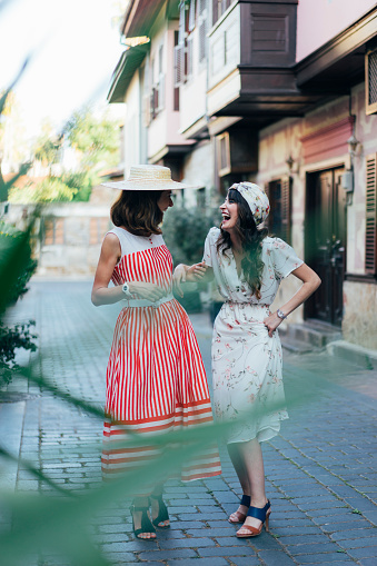 istock Two happy girls while walking 1006189572