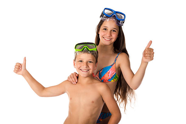 Two happy kids in diving mask standing together stock photo