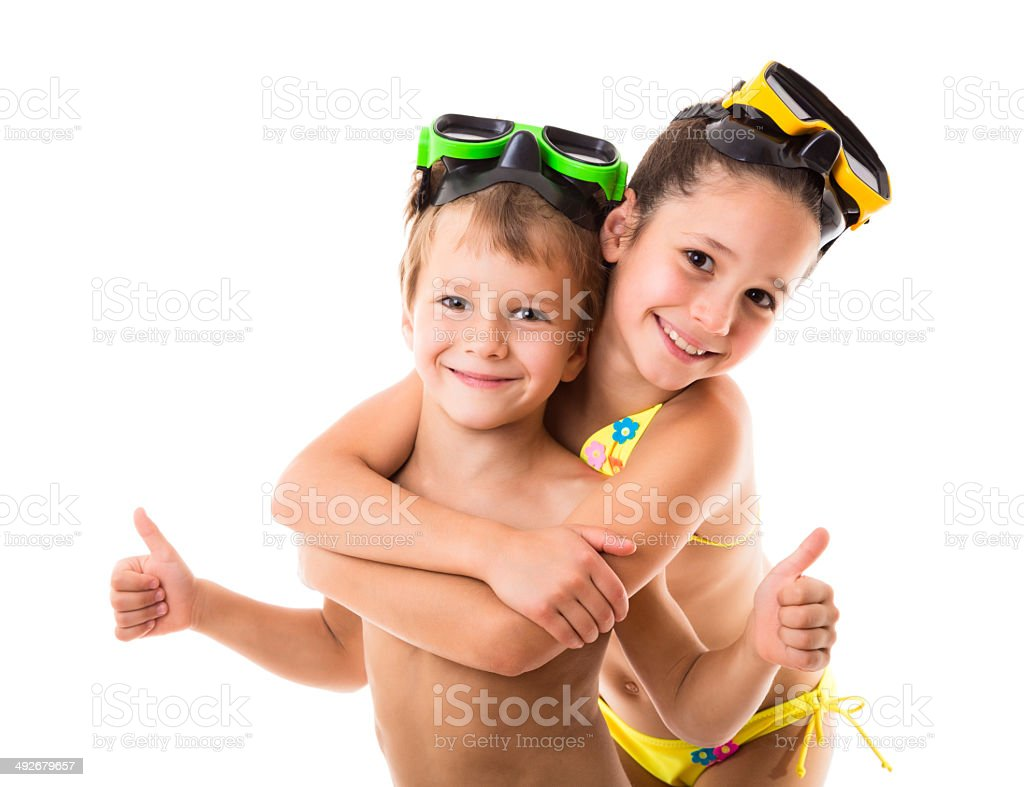 Two happy kids in diving masks stock photo