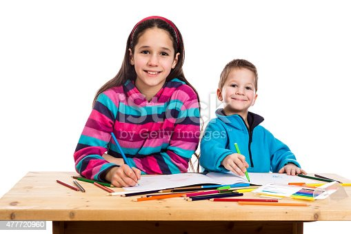818512928istockphoto two happy kids learn to draw together 477720960
