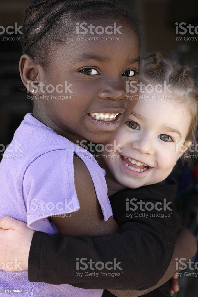 Two Happy Little Girls Smiling and Hugging royalty-free stock photo