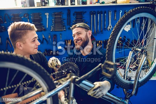 istock Two Happy Mechanics Laughing While Working 1139665256
